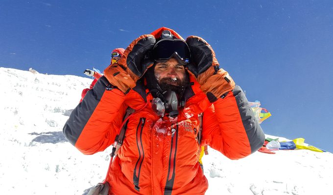 An alpinist on Everest with oxygen mask