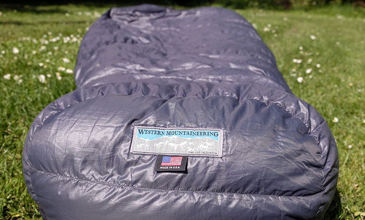 Western Mountaineering Cypress sleeping bag on the grass