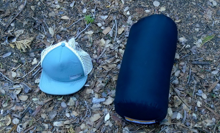 Western Mountaineering Ultralite Mummy Sleeping Bag and a hat on the ground