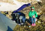 woman camping with apache sleeping bag