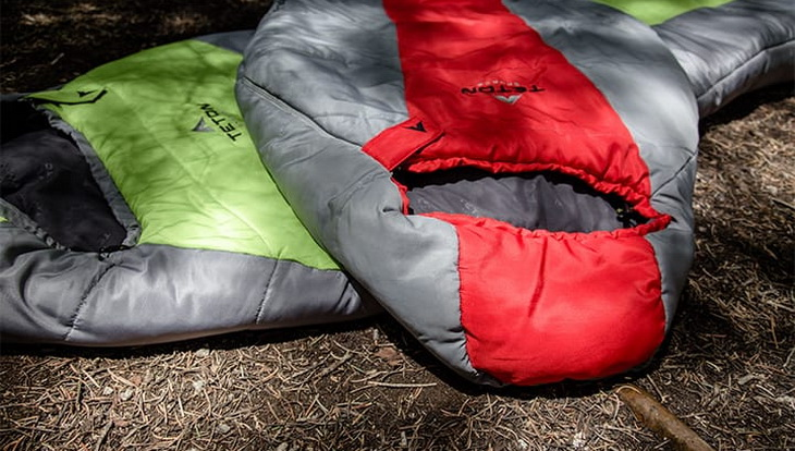 TETON Sports LEEF 0 sleeping bags on the ground in a forest