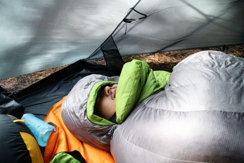 Image showing a man cover with Nemo Nocturne Sleeping Bag