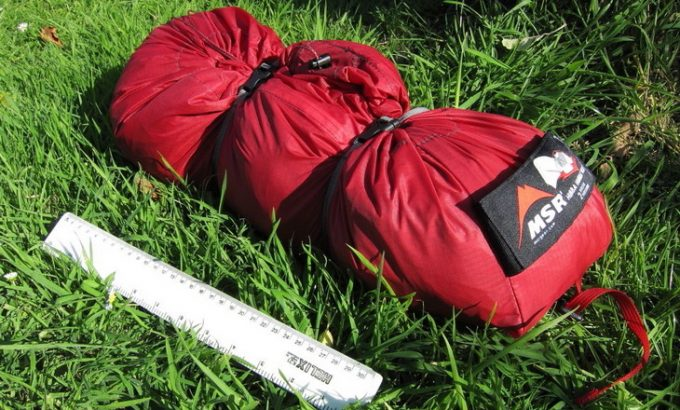 Image showing a MSR Hubba Hubba NX 2-Person Tent packed sitting on the grass