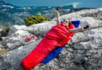 A woman sitting in the Nemo-Fusion-Hybrid sleeping bag