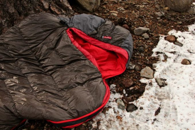 Nemo Nocturne Sleeping Bag on the ground outside near a water