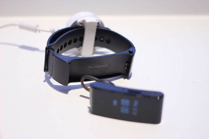 Huawei TalkBand GPS fitness tracker on a white table