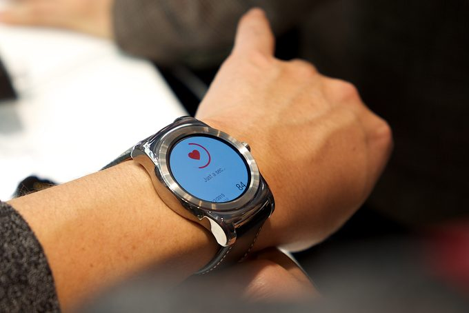 A person wearing android wear smartwatch