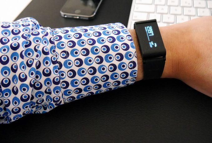 A man wearing a GPS fitness tracker with a long-sleeved shirt