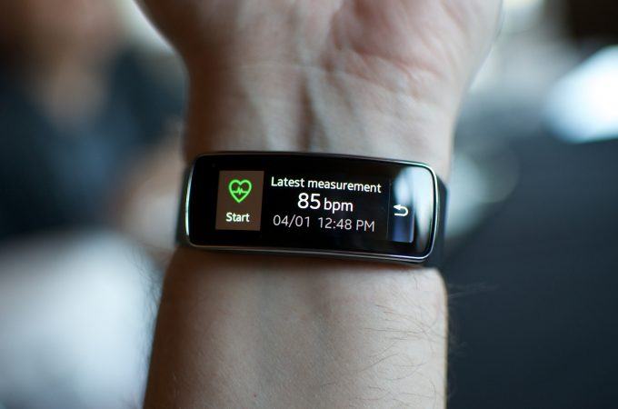 A person wearing activity tracker on left hand