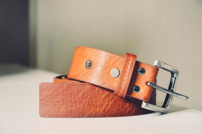 light brown belt on a wooden table