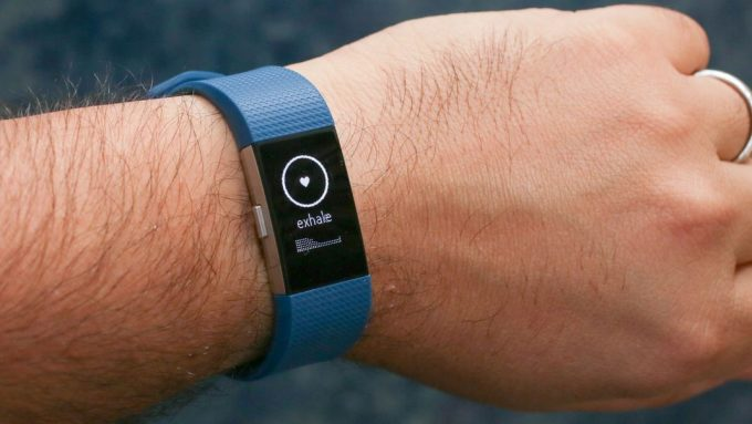 Image of a man wearing Fitbit Charge 2 watch
