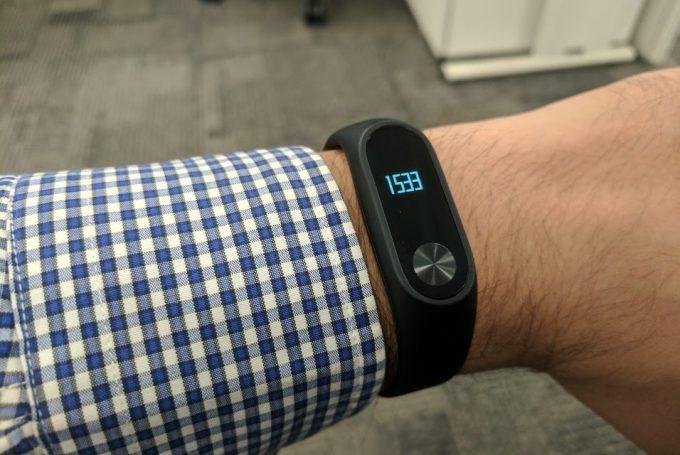 A man wearing the Mi Band 2 activity tracker watch
