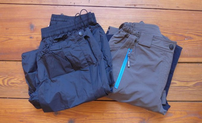 Image showing two pairs of winter hiking pants on a wooden floor