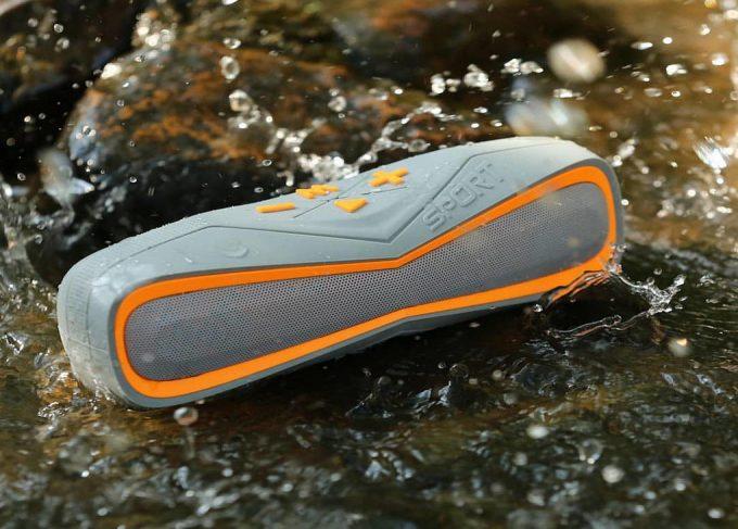 Sport silver and orange Bluetooth speaker is totally waterproof