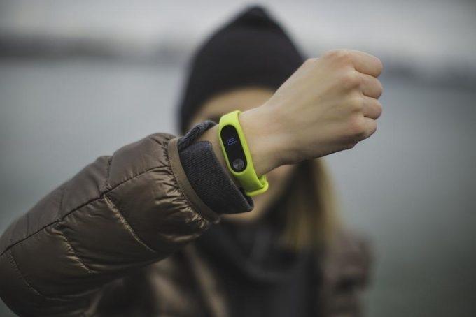 Women wearing light green fitness tracker