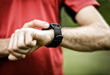 Image showing a runner looking at his fitness watch