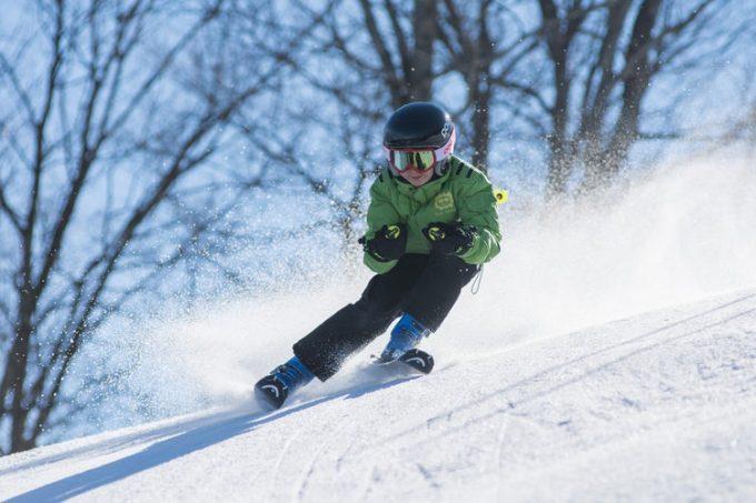 a kid dashing through snow