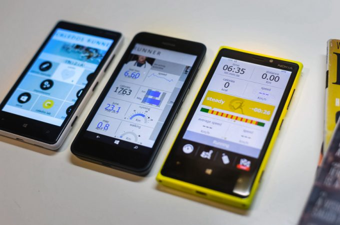 several phones with fitness tracker app