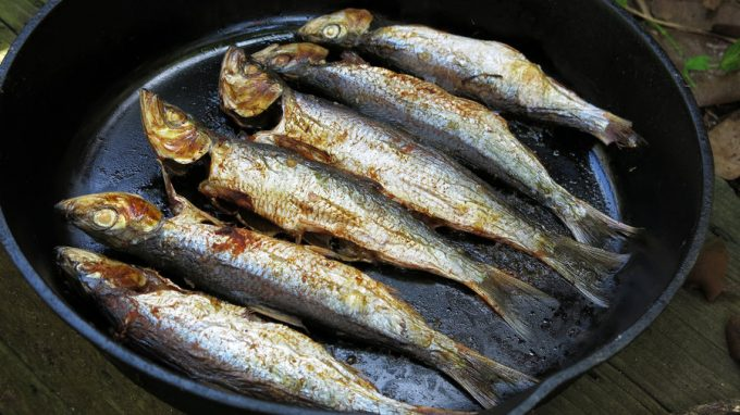 Small fish in a frying pan to be eaten