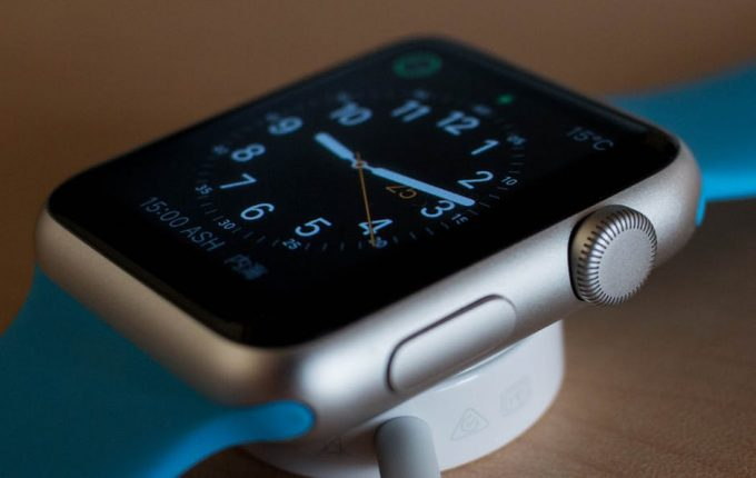 A closer look of a smartwatch for iphones put on a wooden table
