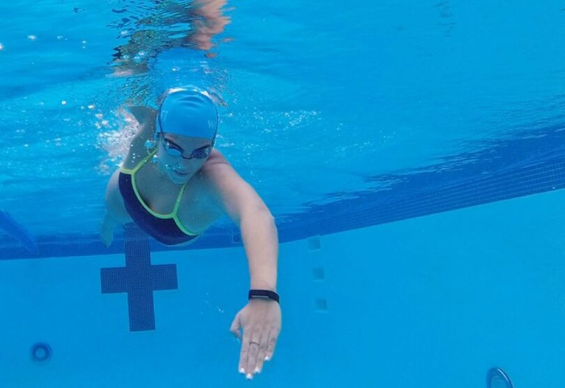 swimmer with Waterfi Fitbit Alta
