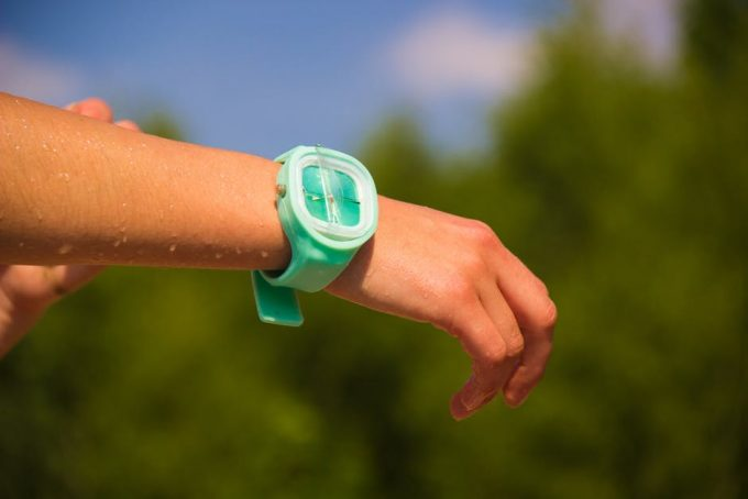 A green fitness watch worn on right hand after jogging