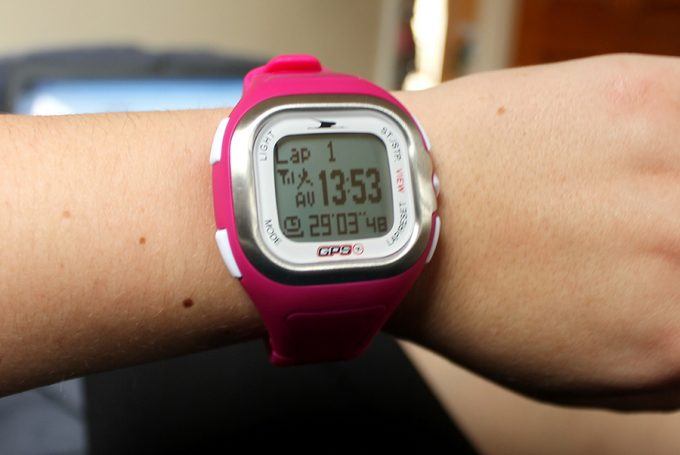 hiker wearing pink gps watch
