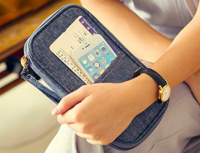 woman holding a waterproof wallet