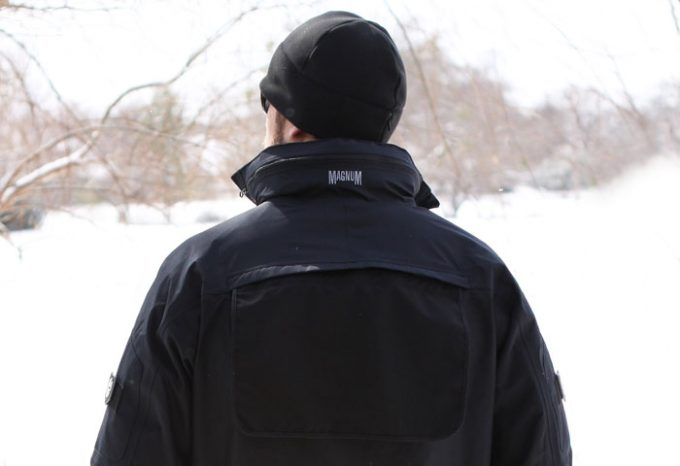 man wearing tactical jacket in snowy weather