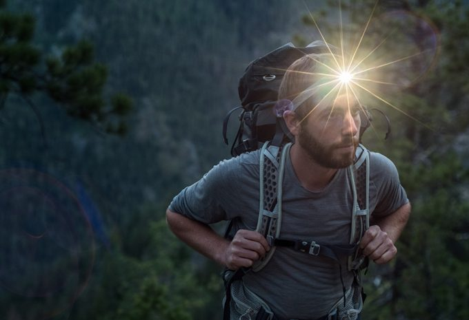 backpacker wearing a headlamp