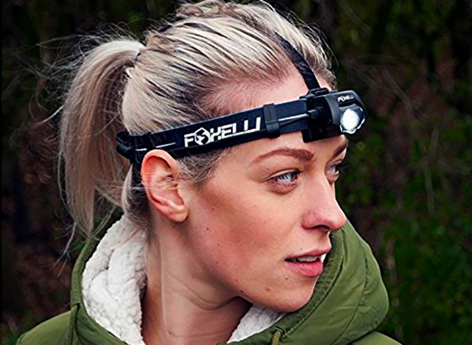 woman wearing a headlamp