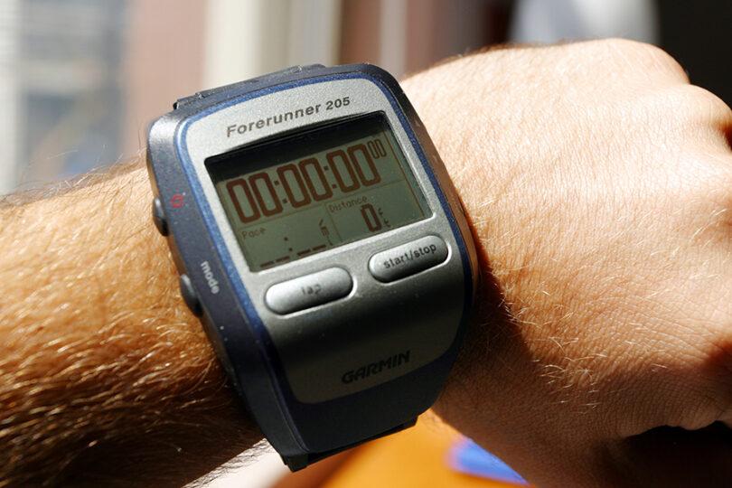 hiker wearing Garmin Forerunner watch