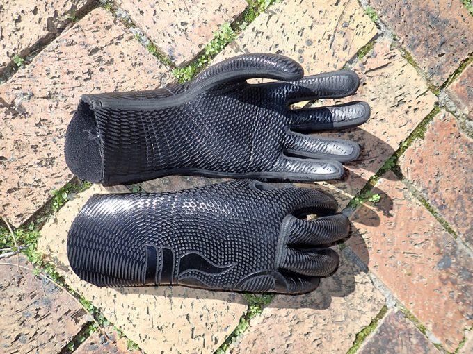 neoprene waterproof gloves on ground