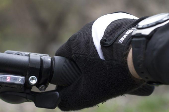 waterproof glove on cyclist