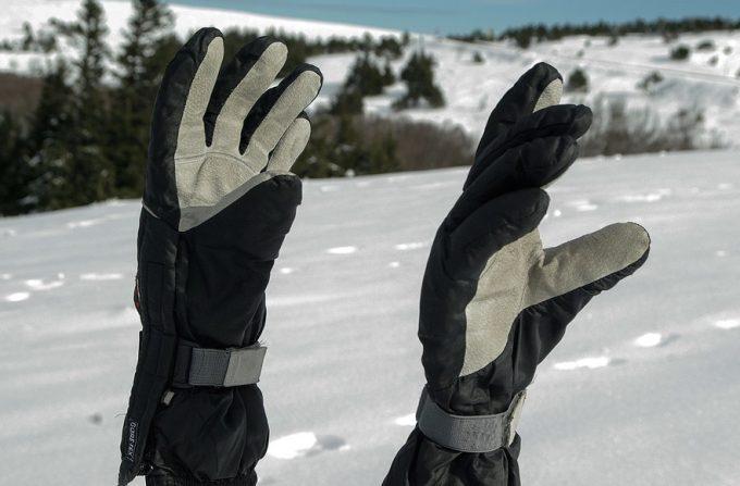 waterproof gloves on skiing sticks