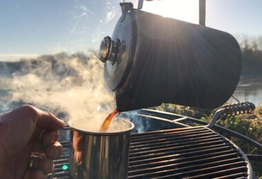 pouring hot coffee from camping pot