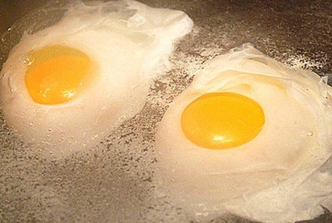 two eggs poaching