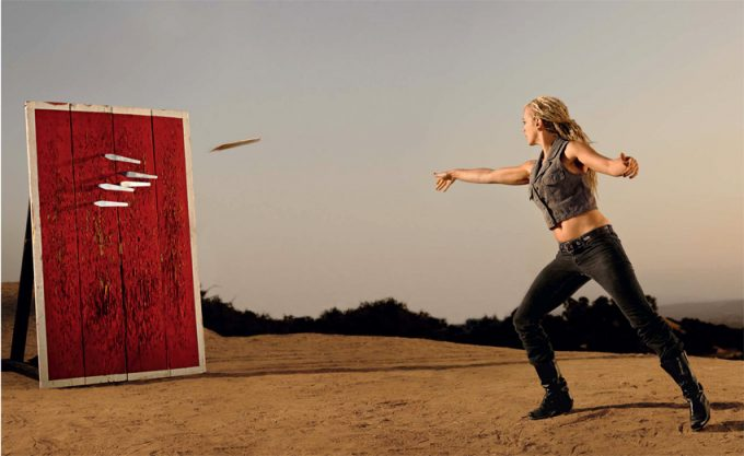 woman throwing knives