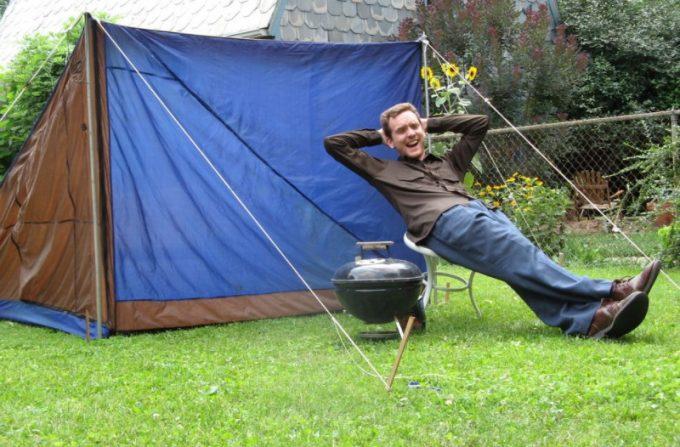 man enjoying near his diy tent
